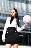 Business woman in sport outfit. With a football ball Royalty Free Stock Photos