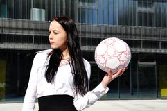 Business woman in sport outfit. With a football ball Stock Photos