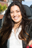 Business woman in sports car. A young successful business woman in a luxurious convertible sports car Royalty Free Stock Images