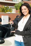 Business woman in sports car. A young successful business woman in a luxurious convertible sports car Royalty Free Stock Photography