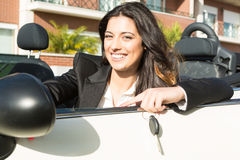 Business woman in sports car. A young successful business woman in a luxurious convertible sports car Stock Photo