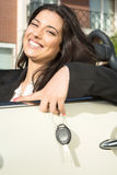 Business woman in sports car. A young successful business woman in a luxurious convertible sports car Royalty Free Stock Photos