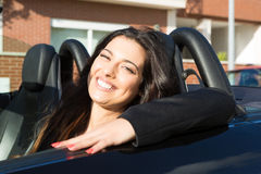 Business woman in sports car. A young successful business woman in a luxurious convertible sports car Stock Photography