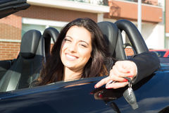 Business woman in sports car. A young successful business woman in a luxurious convertible sports car Royalty Free Stock Photo