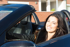 Business woman in sports car. A young successful business woman in a luxurious convertible sports car Stock Photos