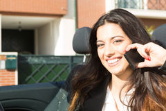 Business woman in sports car. A young successful business woman at the phone in her brand new convertible sports car Royalty Free Stock Image