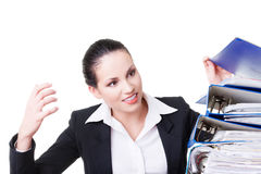 Business woman with stack of binders. Royalty Free Stock Image