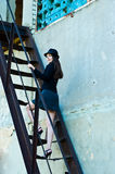 Business woman on the stairs. Businesswoman climbing the ladder of an abandoned building Royalty Free Stock Photo