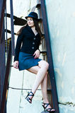 Business woman on the stairs. Business woman sitting on the stairs of the old Stock Photo