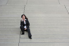 Business woman on the stairs Stock Image