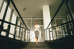 Business woman on stairs Stock Photography