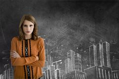 Business woman standing against grey background with city icons Royalty Free Stock Photography