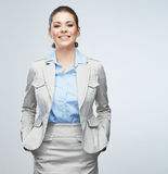 Business woman standing against isolated gray background. Stock Images