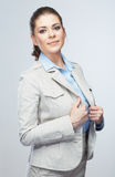 Business woman standing against isolated gray background. Royalty Free Stock Image