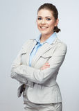 Business woman standing against isolated gray background. Royalty Free Stock Photo