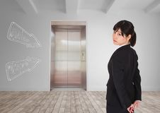 Business woman standing against white room background with white arrows. Digital composite of Business woman standing against white room background with white Royalty Free Stock Photography