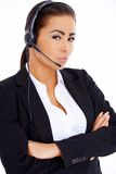 Business woman standing with arms crossed, wearing headset Royalty Free Stock Image