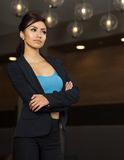 Business woman standing with arms folded Royalty Free Stock Photos