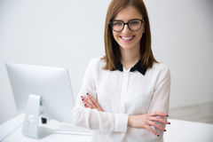 Business woman standing with arms folded Stock Image