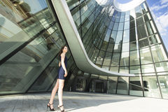 Business woman standing in the background of a modern business center. Royalty Free Stock Photography