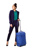 Business woman standing with bag looking away Royalty Free Stock Photos