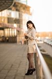 Business woman standing in a big city looks . Royalty Free Stock Images
