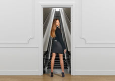 Business woman standing in the doorway going on Royalty Free Stock Photo