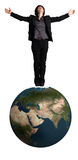 Business woman standing on an earth globe Stock Photography