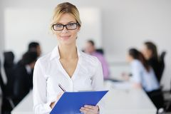 Business woman standing in front of with her staff Stock Photography