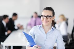 Business woman standing in front of with her staff Stock Images