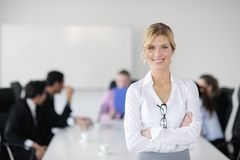 Business woman standing in front of with her staff Royalty Free Stock Photos