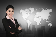 Business woman standing in front of world map. Business globalization concept Royalty Free Stock Photos