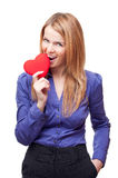 Business woman standing and gnawing red heart Stock Photos