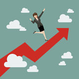 Business woman standing on a growing graph Stock Image