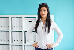 Business woman standing with hands on hips Stock Photos