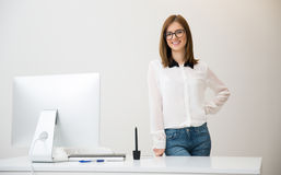 Business woman standing hear her workplace Stock Photo