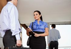 Business Woman Standing With Her Colleague Royalty Free Stock Photography