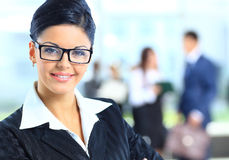 Business woman standing with her staf Stock Photo