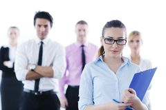 Business woman standing with her staff. Successful business women standing with her staff in background at modern bright office royalty free stock photos