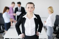 Business woman standing with her staff Stock Photos