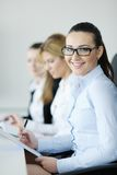 Business woman standing with her staff Stock Images