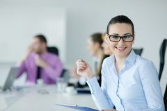 Business woman standing with her staff Royalty Free Stock Photography