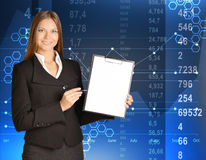 Business woman standing holding a clip board and Stock Photography