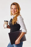 Business woman standing, holding a cup of coffee. Pretty business woman standing, holding a cup of coffee Stock Photos