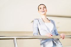 Business woman standing in the lobby of the office Royalty Free Stock Photography