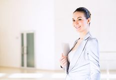 Business woman standing in the lobby of the office Royalty Free Stock Photos