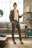 Business woman standing in loft apartment Royalty Free Stock Image