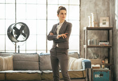Business woman standing in loft apartment Stock Photo