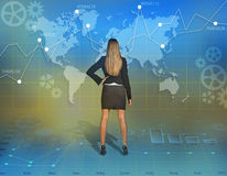 Business woman standing and looking at the world Stock Photos