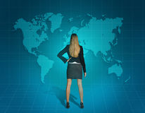Business woman standing and looking at the world Stock Images